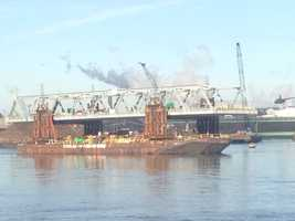 Crews used tugboats and a jack system to lower the span onto a new set of piers, and then send the barge back to Port Authority so workers can assemble the second span.