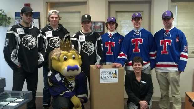 Manchester Monarchs and Trinity High School hockey players help kick off the Put Hunger on Ice food drive.