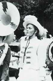 In high school, Erin played the tenor and baritone saxophone and was the drum major of her high school marching band.