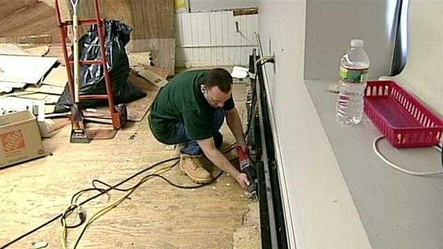 Crews work to repair damage to school