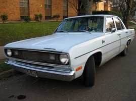 Jamie'sfirst car was a baby-blue Plymouth Valiant with a white roof.