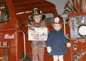 """Growing up, Jamiewanted to be a fireman. """"My dad used to take my picture on the Salem or Windham fire trucks for my birthday everyDecember,"""" Jamie said."""