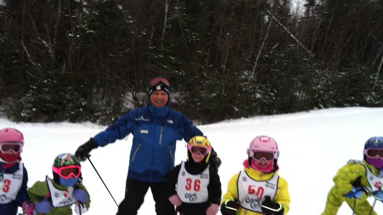 Waterville Valley's beloved instructor, Ron Boulay, and his little companions, on Sunday, Jan. 20 as it snowed. Ron has been teaching kids, ages 5 to 7, the joy of skiing for 45 years at Waterville Valley. He hasn't missed a single weekend day with these kids in all that time.