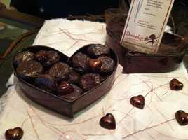 "This chocolate-sculpted heart box and truffles is from ""Dancing Lion Chocolate"" in Manchester."