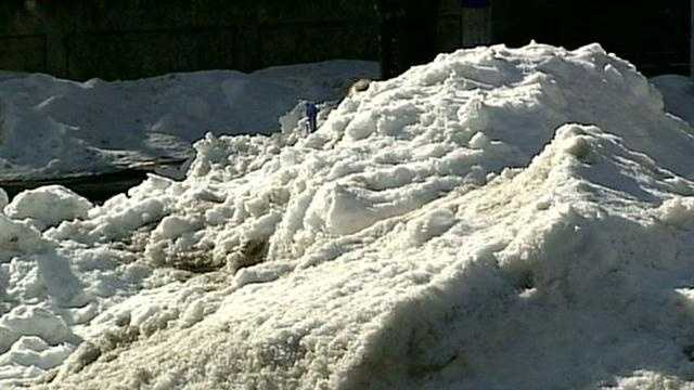 Towns work to clear snow piles