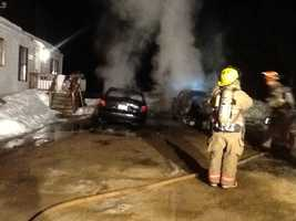 New Hampshire fire crews assisted in the rescue of a man from a burning vehicle in Lebanon, Maine on Thursday morning.