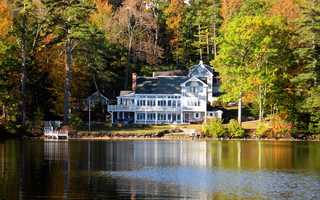 This elegant nine-bedroom lake home is situated on two lots of 5.38 acres and 200 feet of shoreline on Lake Winnipesaukee for amazing privacy. This is a rare property that happens to be wonderful for entertaining large groups, whether it be inside or outside.