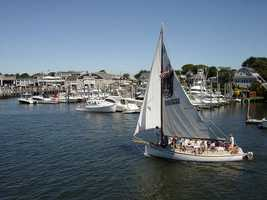Mike's first job was as a…summer camp counselor and sailing instructor on Cape Cod.