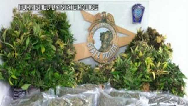 State police say a drug raid led to the discovery of two marijuana growing rooms in a Manchester home.