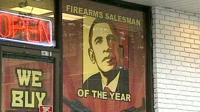Gun store has controversial sign in front of shop.