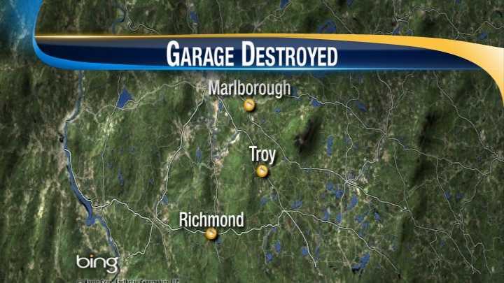 Garage fire destroys several snowmobiles, car