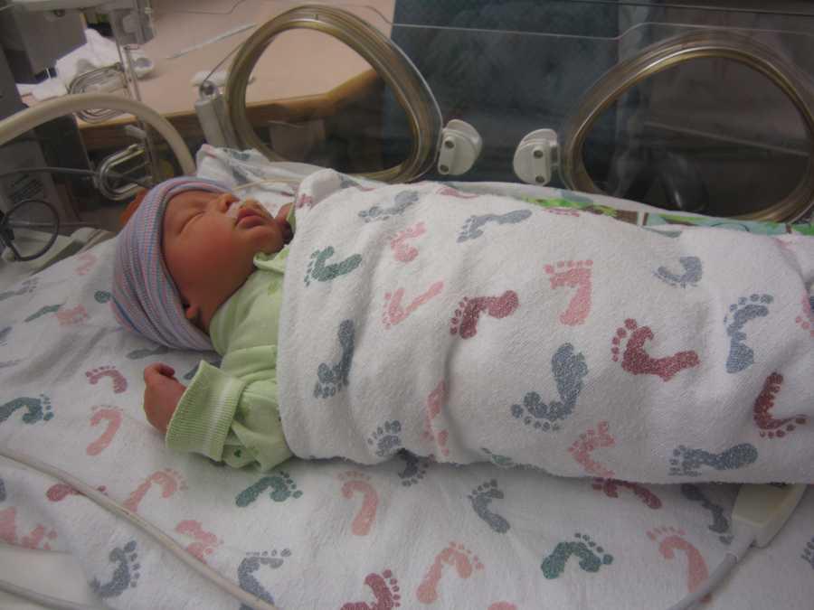 Baby Callum in newborn isolette.