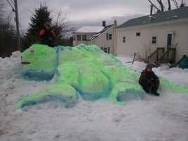 Snow dinosaur made in the Lakes Region