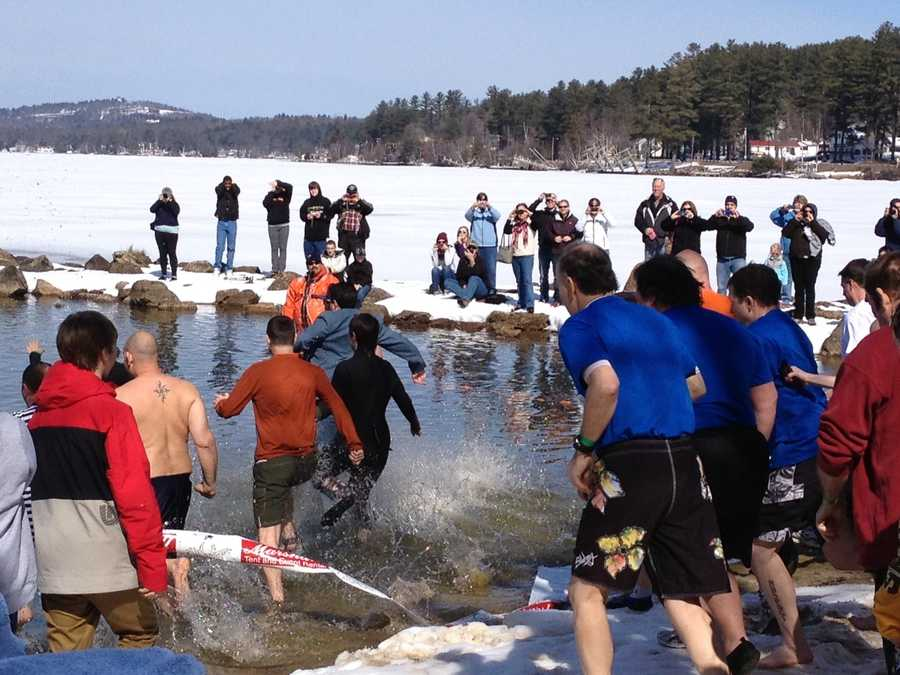 "The milder weather returned just in time for the annual ""Winni Dip"" at Lake Winnipesaukee this weekend."