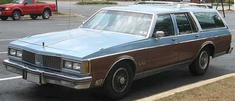 """Jean's first car was """"the ginormous family Oldsmobile station wagon that my parents let me drive. It was pale yellow and not cool at all but I was thankful to have a car,"""" said Jean."""