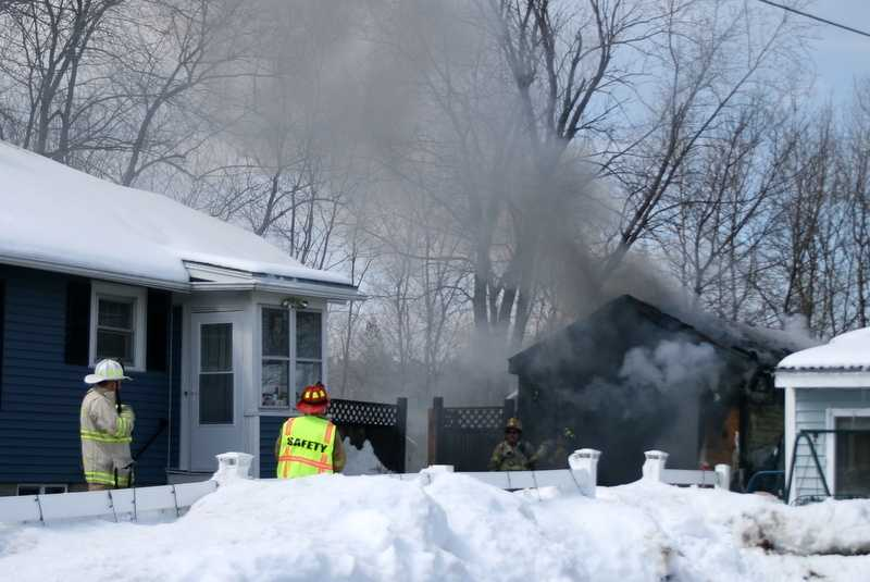 The garage and vehicle inside was fully engulfed in flames, and the garage was destroyed.