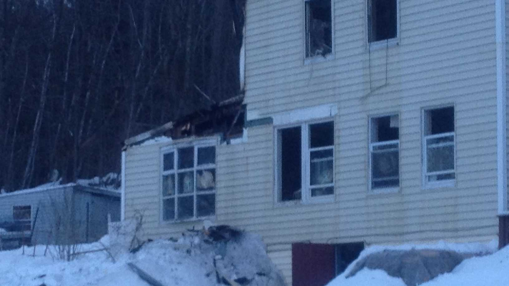 Flames burned through a Pittsfield house early Friday morning