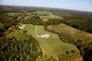 The home on Old Mill Lane in Rollinsford is set on 50 private acres.