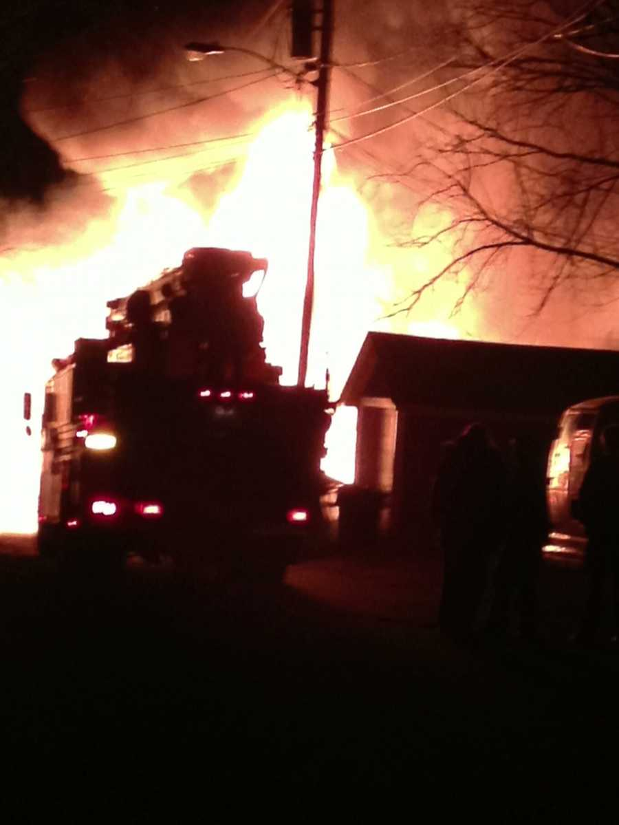 Officials said a fire Friday morning a west side apartment building in Manchester was intentionally set.