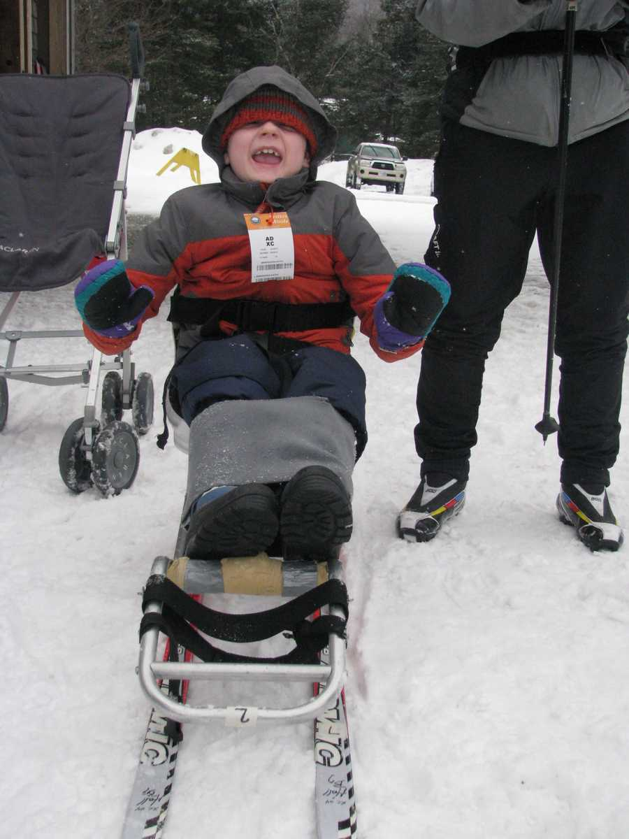 Lewis Bellows, 9, of East Kingston and his family are now able to cross country ski together, thanks to an adaptive program based out of Durham.