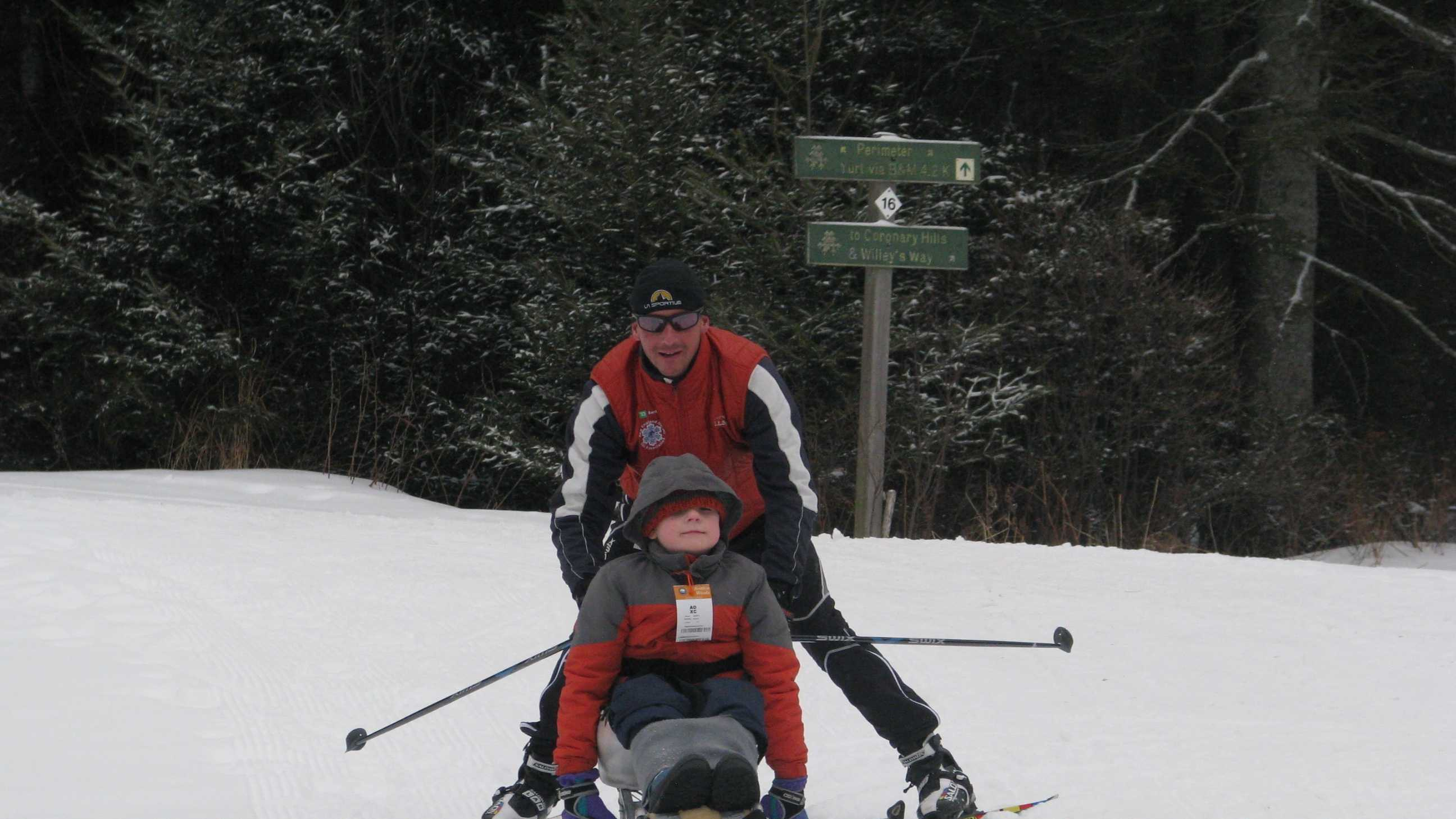 Lewis Bellows, 9, of East Kingston learns how to cross country ski in a sit ski with  instructor Patrik Viljanen, adaptive program manager for the New England Nordic Ski Association at Bretton Woods.