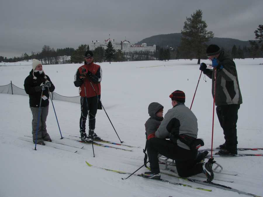 The family of Lewis Bellows and members of Northeast Passage and the New England Nordic Ski Association cross country ski at Bretton Woods recently with the Mount Washington Hotel in distance.