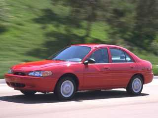 """My first car was a 1998 Ford Escort sedan in bright red. Yuck!"" said Melinda."