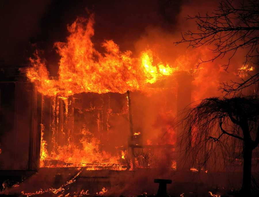 Officials are investigating the cause of a two-alarm fire that broke out at an apartment building on School Street in Concord just after 12:30 a.m. on Friday.