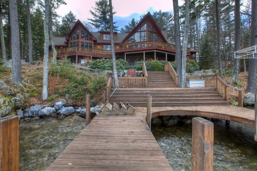 This Alton home features four bedrooms, six bathrooms and views all the way across Lake Winnipesaukee to the Ossipee Mountains.
