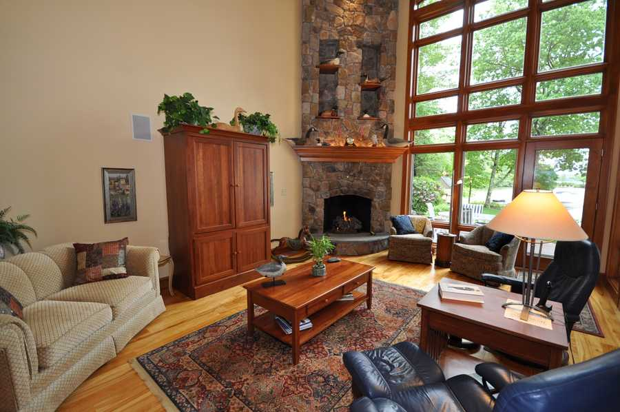 This main house also includes hardwood flooring and furniture finish natural woodwork.