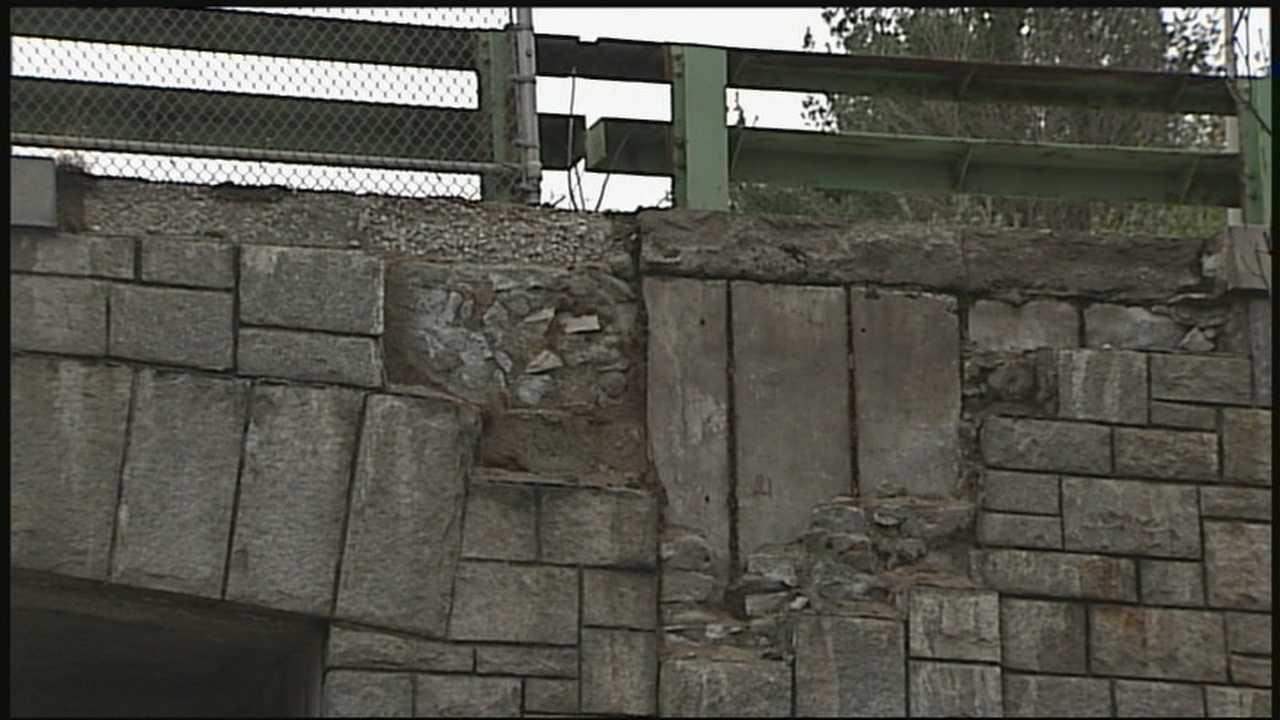 Bricks fall from bridge facade