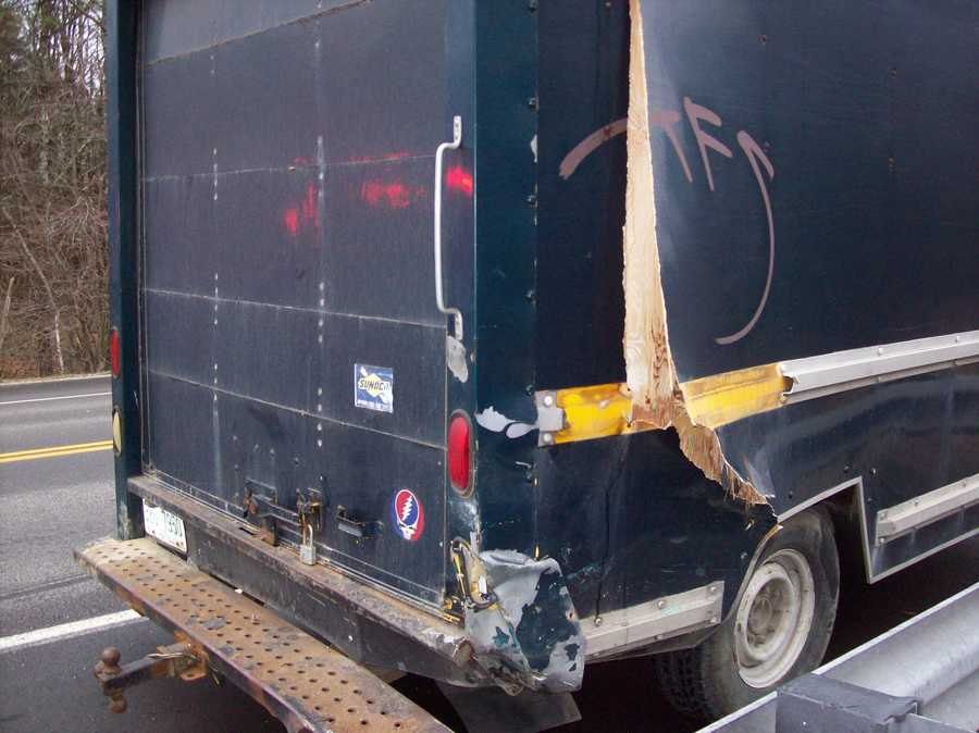 Police said a car hit this box truck, swerved into a guardrail, and then hit an SUV, which hit a fourth car.