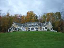 The home has been featured in Country Living Magazine. It has French doors with transom windows to capture views of the Western White Mountains. It also features custom designed Vermont Maple floors throughout the first and second floors and two fireplaces.