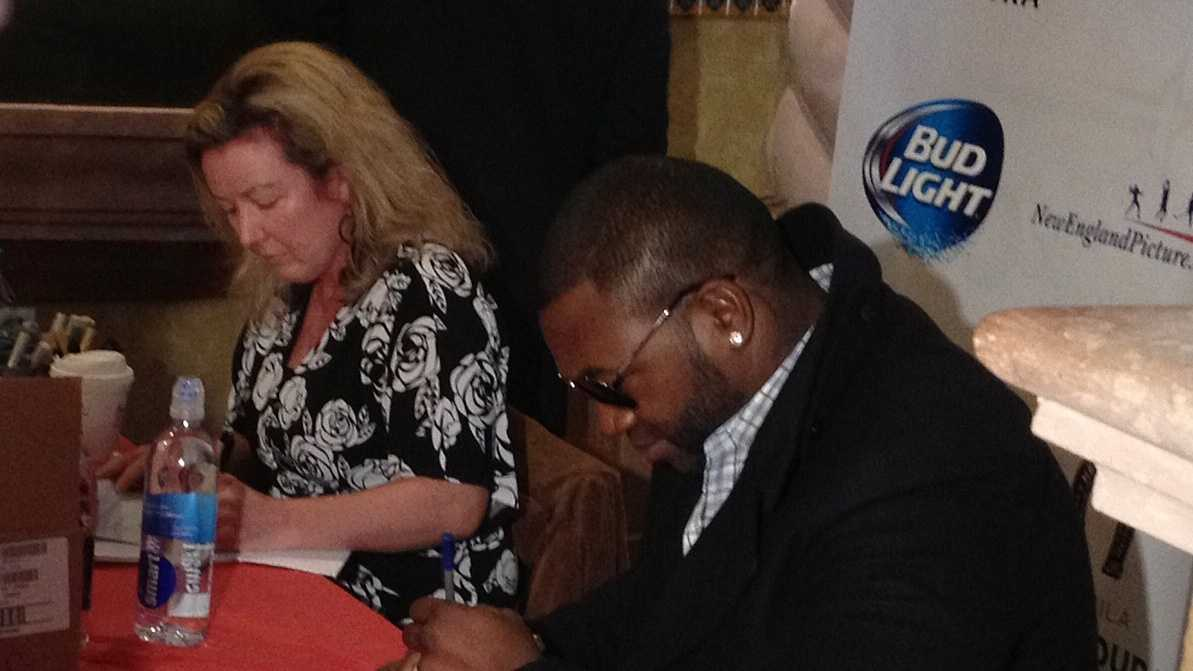 David Ortiz signs autographs in Derry on Saturday.