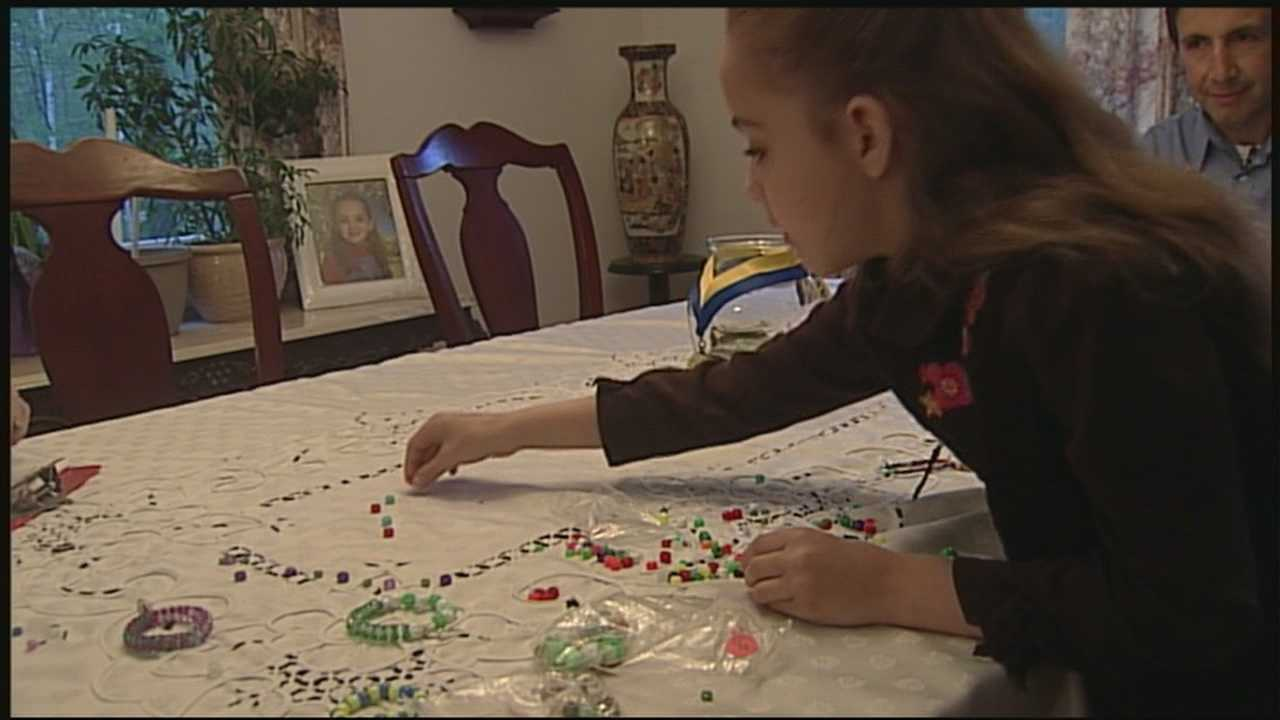 Girl makes bracelets to support Boston One Fund