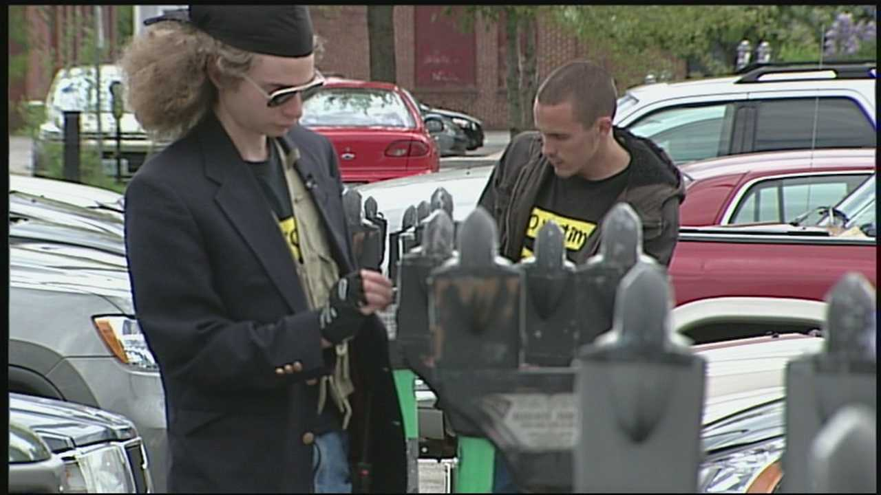 The city of Keene is accusing a group that feeds parking meters of harassing parking enforcement officers.