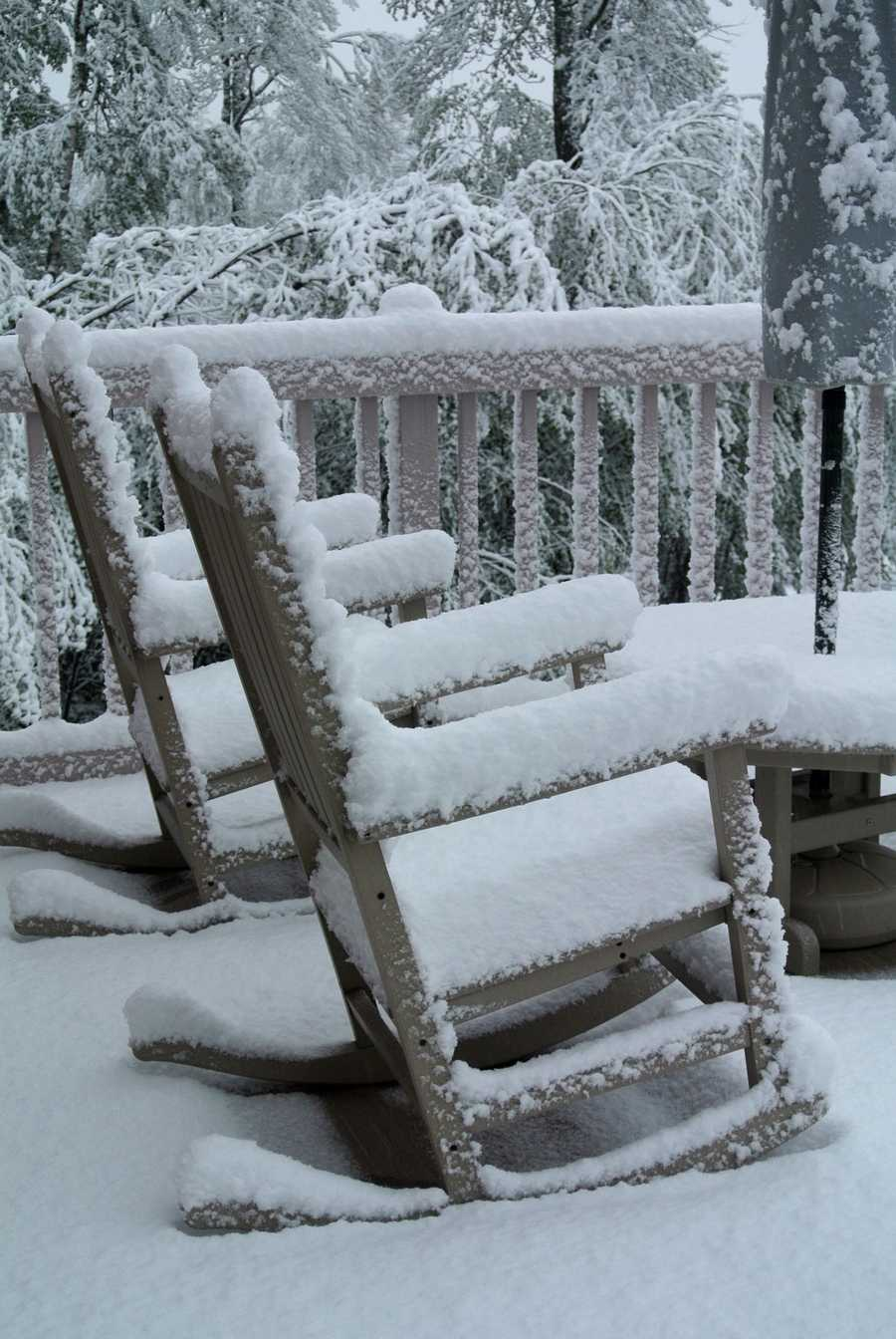 These deck chairs are covered with snow in Bretton Woods.
