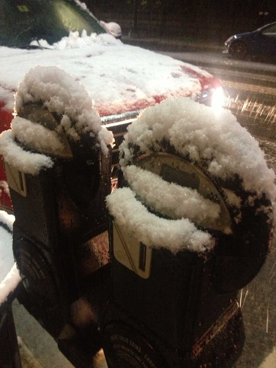 Snow covered parking meters in Littleton