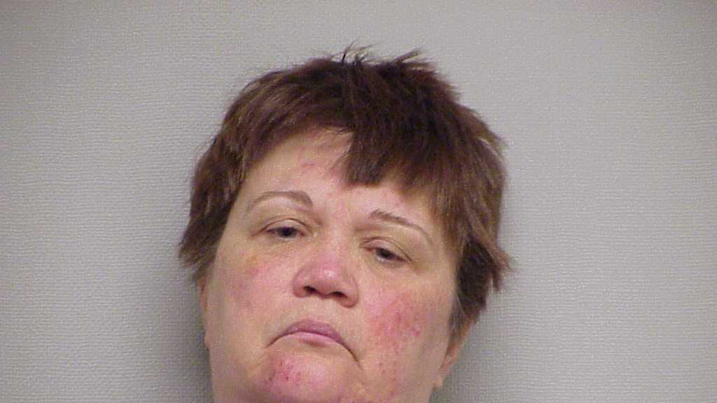 Portsmouth police arrested Cheryl Lees on Sunday after they say she robbed a Rite Aid Pharmacy, ran from police and crashed her vehicle into another car.