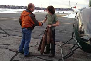 Jake's father, Neil Rabideau, congratulates him after a successful first solo flight