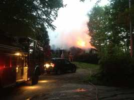 A fire at a home in Hooksett led to a road closure Thursday morning.