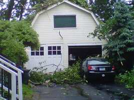 A tree pierced this garage after falling during the storm.