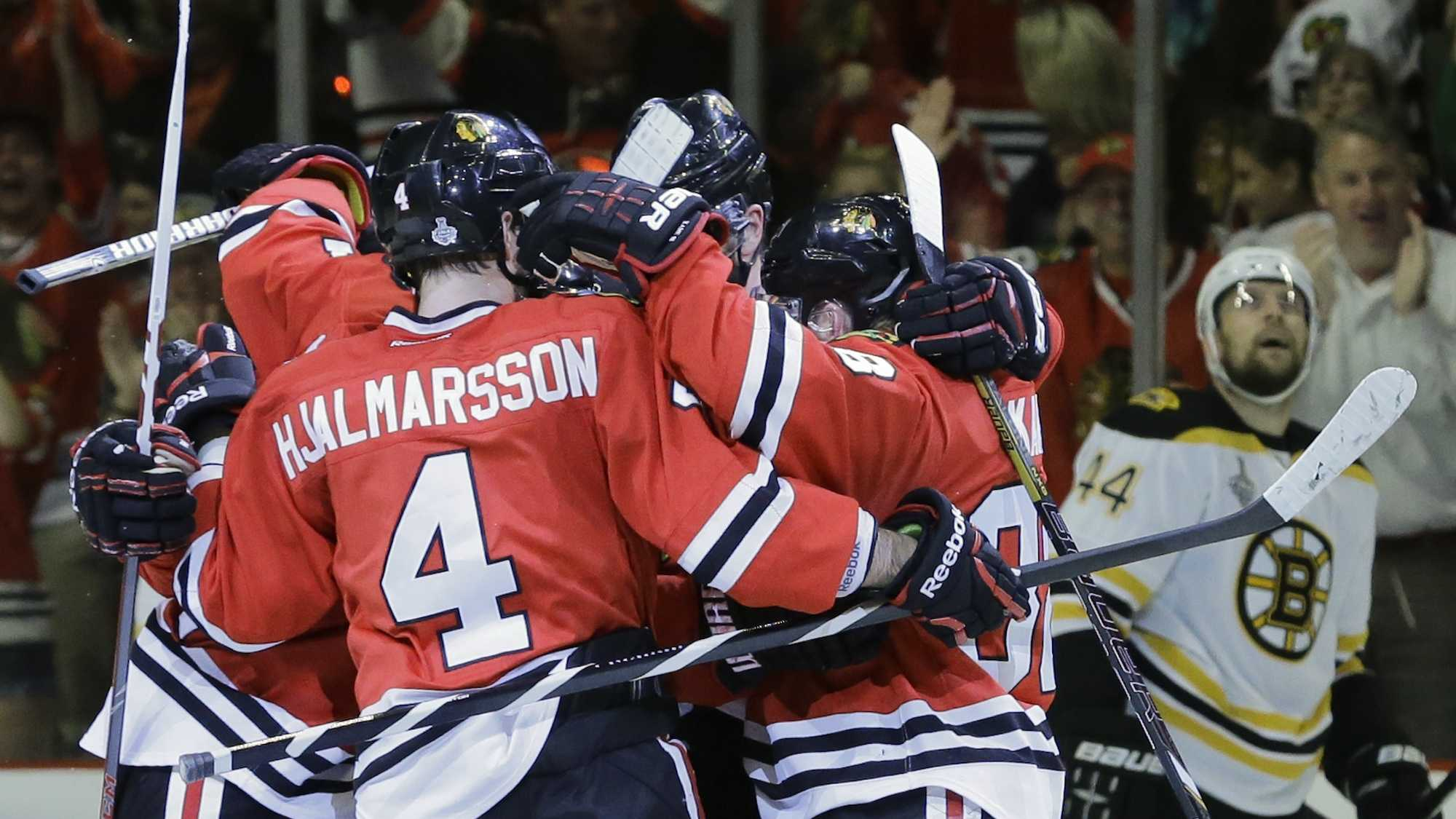 The Chicago Blackhawks celebrate a second period goal against the Boston Bruins during Game 5 of the NHL hockey Stanley Cup Finals, Saturday, June 22, 2013, in Chicago.