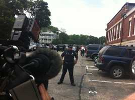 Police control the media and the crowd outside the Attleboro District Court Wednesday afternoon.