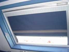 Put shades on garage and shed windows to keep people from seeing valuables inside.