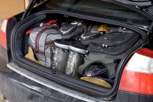 Remove items you don't need. One hundred pounds extra in the car means a loss of 2 percent mileage.