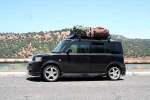 Don't pack on top of your car, as it increases drag. Pack everything inside of your car.
