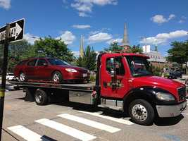 Savyon's car is towed by authorities.