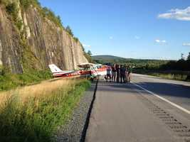 A plane experiencing engine trouble made an emergency landing on Interstate 89 in New London just after 5 p.m. Sunday, authorities confirmed.