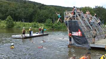 """On """"Walk the Plank,"""" Mudders face their fear of heights as they leap into chilly waters below."""